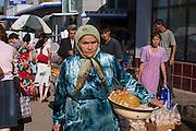 Tashkent, Uzbekistan, 12/05/2004..A tradeswoman at Chorsu [Chor Su] market, in central Tashkent.
