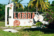 The unusual brick and sculpture entrance sign to Florida, Cuba, known as the Land of Flowers.