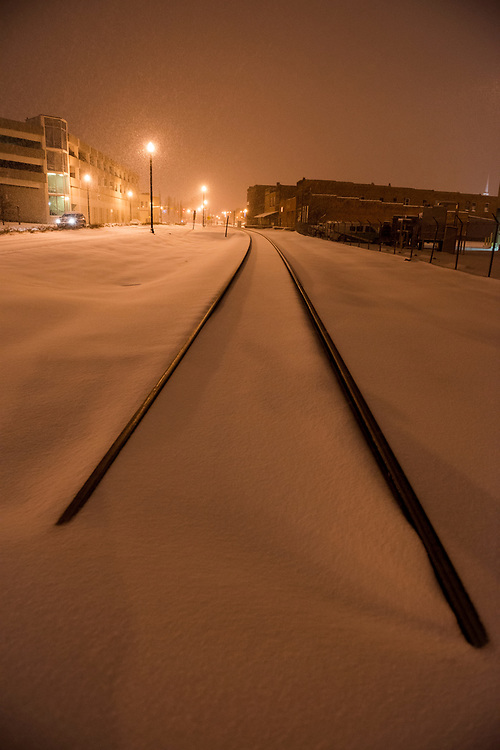 Fresh snow falls on train tracks in downtown Johnson City, Tennessee.  (February 12, 2014)