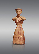 Minoan clay female figurine in the attitude of worship, Chamezi 1900-1700 BC; Heraklion Archaeological  Museum, grey background. .<br /> <br /> If you prefer to buy from our ALAMY PHOTO LIBRARY  Collection visit : https://www.alamy.com/portfolio/paul-williams-funkystock/minoan-art-artefacts.html . Type -   Heraklion   - into the LOWER SEARCH WITHIN GALLERY box. Refine search by adding background colour, place, museum etc<br /> <br /> Visit our MINOAN ART PHOTO COLLECTIONS for more photos to download  as wall art prints https://funkystock.photoshelter.com/gallery-collection/Ancient-Minoans-Art-Artefacts-Antiquities-Historic-Places-Pictures-Images-of/C0000ricT2SU_M9w