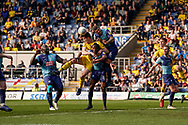 Rob Dickie of Oxford United heads the ball in the penalty area under pressure during the EFL Sky Bet League 1 match between Oxford United and Wycombe Wanderers at the Kassam Stadium, Oxford, England on 30 March 2019.