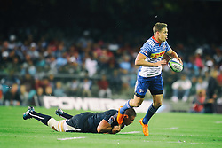 Sarel Marais of the DHL Stormers evades the tackle during the Super Rugby match between the DHL Stormers and the Vodacom Blue Bulls at Newlands Stadium in Cape Town on the 25th February 2017