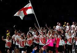 England's flag bearer Alistair Brownlee leads the team out during the Opening Ceremony for the 2018 Commonwealth Games at the Carrara Stadium in the Gold Coast, Australia.
