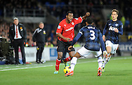 Cardiff City's Kevin Theophile - Catherine takes on Manchester United Captain Patrice Evra.<br /> Barclays Premier League match, Cardiff city v Manchester Utd at the Cardiff city stadium in Cardiff, South Wales on Sunday 24th Nov 2013. pic by Phil Rees, Andrew Orchard sports photography,