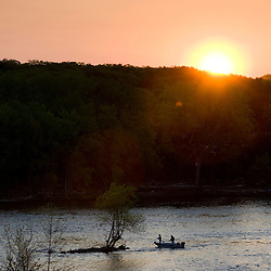 Fisherman casting for shad in the Connecticut River in Holyoke, Masschusetts.  Sunrise.