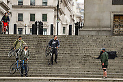 Cyclists are seen carrying their bicycles through the stairs near Trafalgar Square in London, Britain, on Sunday, May 3, 2020. Britons are now in their sixth week of lockdown due to the Coronavirus pandemic. Countries around the world are taking increased measures to stem the widespread of the SARS-CoV-2 coronavirus which causes the Covid-19 disease. (Photo/ Vudi Xhymshiti)