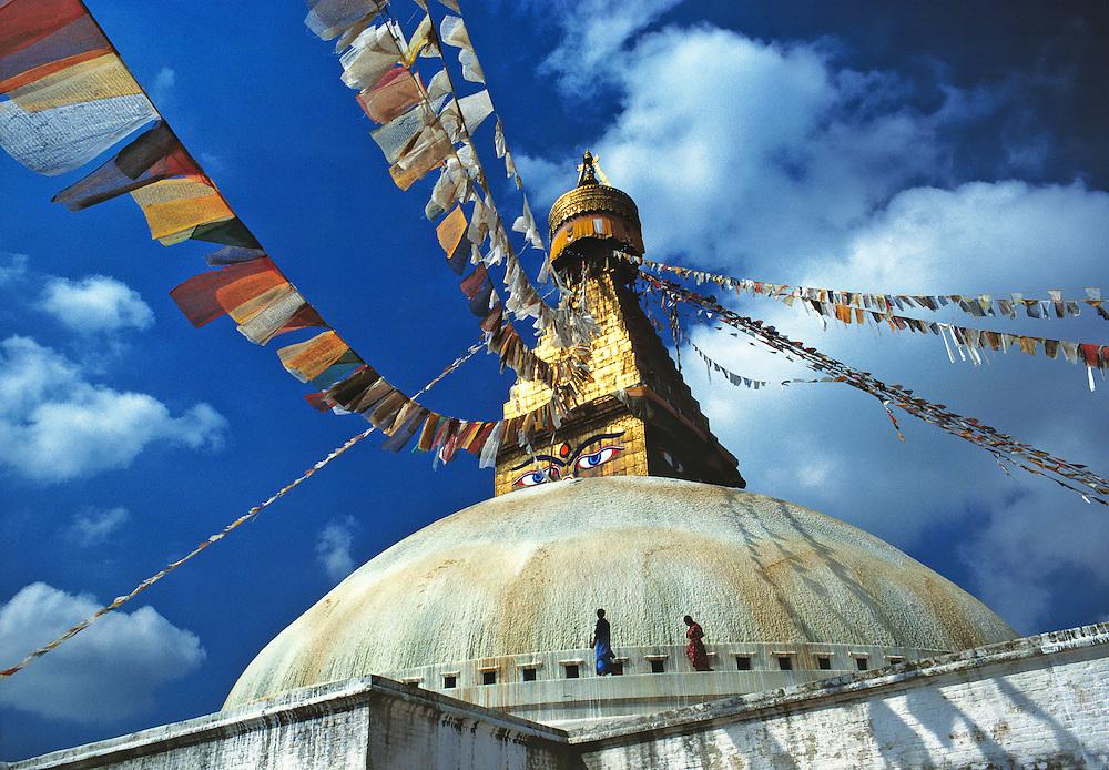 Prayer flags fly at Bodnath Stupa, Kathmandu, Nepal.