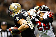 NEW ORLEANS, LA - NOVEMBER 11:  Jimmy Graham #80 of the New Orleans Saints stiff arms Thomas DeCoud #28 of the Atlanta Falcons on his way for a touchdown at Mercedes-Benz Superdome on November 11, 2012 in New Orleans, Louisiana.  The Saints defeated the Falcons 31-27.  (Photo by Wesley Hitt/Getty Images) *** Local Caption *** Jimmy Graham; Thomas DeCoud Sports photography by Wesley Hitt photography with images from the NFL, NCAA and Arkansas Razorbacks.  Hitt photography in based in Fayetteville, Arkansas where he shoots Commercial Photography, Editorial Photography, Advertising Photography, Stock Photography and People Photography
