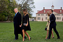 U.S. President Donald Trump, from left, U.S. First Lady Melania Trump, Brigitte Macron, France's first lady, and Emmanuel Macron, France's president, walk outside the Mansion at the Mount Vernon estate of first U.S. President George Washington in Mount Vernon, Virginia, U.S., on Monday, April 23, 2018. As Macron arrives for the first state visit of Trump's presidency, the U.S. leader is threatening to upend the global trading system with tariffs on China, maybe Europe too. Photographer: Andrew Harrer/Bloomberg