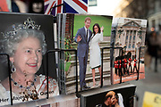 Harry and Meghan postcards next to a postcard of Queen Elizabeth II for sale as if they are waving goodbye to the UK on a rack on 21st January 2020 in London, England, United Kingdom. Earlier it had been reported that after recent controversy and discussion amongst members of the royal family, that Prince Harry had flown out of the UK to be with his wife Meghan and their family. Prince Harry and Markle announced recently that they will step back from their roles as senior royals to share their time between the UK and Canada, and to continue both their charity work and continue to a degree their royal responsibilities.