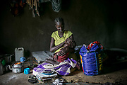 Seventeen-year-old Nyabuol Tut caresses her two-year-old daughter, Nyalit, who has deformed hands and feet (not shown) inside Bidibidi refugee settlement in northern Uganda. Nyabuol was gang-raped by Dinka soldiers twice, both in December 2015 and March 2017. She gave birth to Nyalit from the first rape by four soldiers and is eight months pregnant from the second rape by seven armed Dinka men. Her parents were shot to death by Dinka soldiers in between both conflicts in 2013 and 2016.