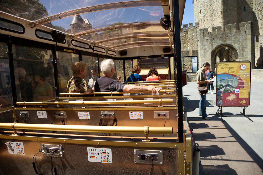 people sitting and waiting for there tour around the tourist attraction starts France