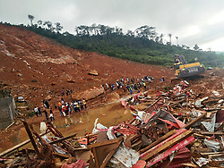 (170815) -- FREETOWN, Aug. 15, 2017 (Xinhua) -- Rescuers and a mechanical digger work at the site of mudslide during a rescue operation in Freetown, Sierra Leone, on Aug. 14, 2017. Government of Sierra Leone is expected on Tuesday to undertake the burial of the majority of corpses of victims in the devastating mudslide which had claimed nearly 300 lives, sources close to the government told Xinhua.  (Xinhua/Wang Bo) (zf) (Photo by Xinhua/Sipa USA)