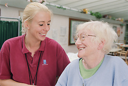 Female occupational therapist or physiotherapist and elderly woman smiling during session to improve balance and stability in hospital,