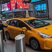 A lady hails a cab during the holiday season with Coronavirus (Covid-19) outbreak in Manhattan, New York on Tuesday, December 8, 2020. (Alex Menendez via AP)