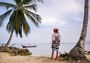 The Kuna: the last tribe of the Caribbean <br /><br />500 years ago, the Kuna people lived on the border between Panama and Colombia. In the early 18th century, when the Spanish conquistadors expanded the presence in the area, the Kuna began to emigrate to the San Blas islands where no foreigners were permitted until the late 1940s. Some say Christopher Columbus discovered this land, but the Kuna retort that they have occupied it for centuries. Of the 365 islands, approximately 40 are inhabited and overcrowded!<br />Either a boat or plane is needed to reach the San Blas islands where the 50,000 Kuna live. They have gained a certain level of autonomy and in the process, have successfully maintained their traditions and customs. <br />If arriving by boat, it feels like you are approaching paradise itself. Small plots of land emerge from the sea. These tiny islands are covered by palm trees, which provide little shade to the Kuna's thatch huts. Fishermen slowly drift across the water in their pirogues. Once on the islands, the Kuna women are the first to greet you. They are characteristically short and all wear a traditional, recognizable attire featuring a red shawl, a skirt, beaded bracelets and necklaces, a gold nose ring, and at least one Mola design on the fabric. Mola art was once painted on the body but was relegated to clothing under the influence of the missionaries. Earliest accounts of Mola fashion date back to 1514!<br />Using the technique of reverse application, artists create images depicting natural scenes including landscapes and wildlife, as well as more abstract geometrical patterns. Since some on these islands have TV, animals like elephants are also represented, even though they are not indigenous to the area.  In the modern metropolis of Panama city, the Kuna women proudly wear their traditional clothing in the streets. Museums around the world exhibit molas.<br />Even school uniforms on the islands are influenced by the mola art.<br />The Kuna ha