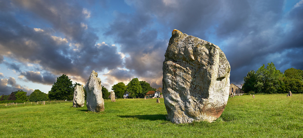 Avebury Neolithic standing stone Circle the largest in England, Wiltshire, England, Europe, Avebury Neolithic standing stone Circle the largest in England, Wiltshire, England. Avebury is a Neolithic henge monument containing three stone circles, around the village of Avebury in Wiltshire, in southwest England. One of the best known prehistoric sites in Britain, it contains the largest megalithic stone circle in the world. Constructed over several hundred years in the third millennium BC, during the Neolithic, or New Stone Age, the monument comprises a large henge (a bank and a ditch) with a large outer stone circle and two separate smaller stone circles situated inside the centre of the monument.<br /> <br /> Visit our PREHISTORIC PLACES PHOTO COLLECTIONS for more  photos to download or buy as prints https://funkystock.photoshelter.com/gallery-collection/Prehistoric-Neolithic-Sites-Art-Artefacts-Pictures-Photos/C0000tfxw63zrUT4