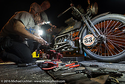 Andy Kaindl of Germany works on his 4-cylinder 1915 Henderson class-2 motorcycle in Cape Girardeau during the Motorcycle Cannonball Race of the Century. Stage-5 from Bloomington, IN to Cape Girardeau, MO. USA. Wednesday September 14, 2016. Photography ©2016 Michael Lichter.