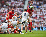 Danny Care clears the ball under pressure from Wales' Jake Ball during the The Old Mutual Wealth Cup match England -V- Wales at Twickenham Stadium, London, Greater London, England on Sunday, May 29, 2016. (Steve Flynn/Image of Sport)