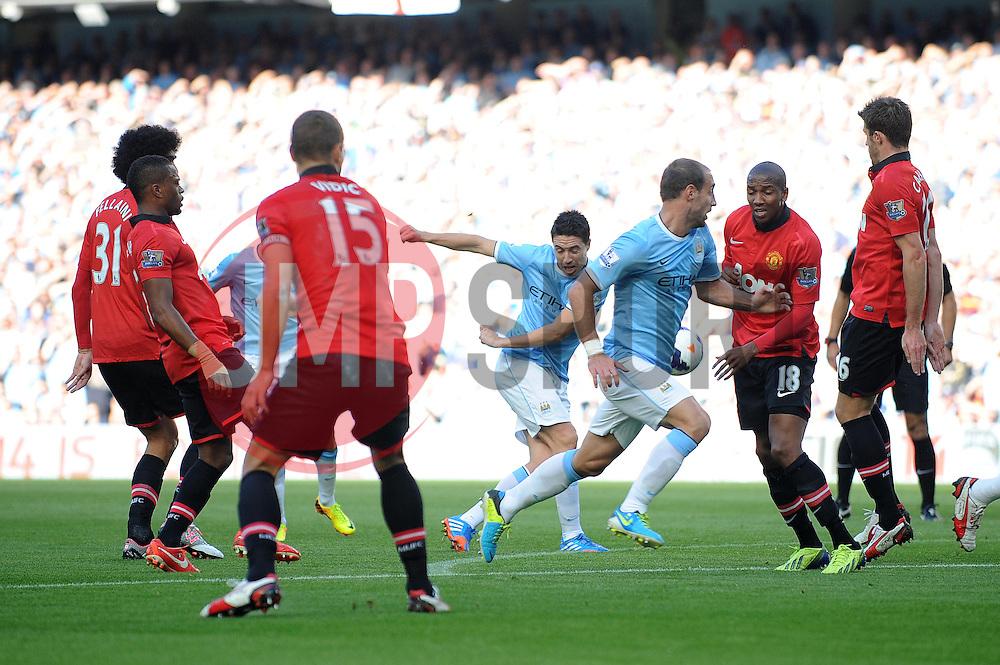 Manchester City's Samir Nasri takes a shot at goal. - Photo mandatory by-line: Dougie Allward/JMP - Tel: Mobile: 07966 386802 22/09/2013 - SPORT - FOOTBALL - City of Manchester Stadium - Manchester - Manchester City V Manchester United - Barclays Premier League