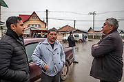 Roma activists Marius and Gheorghe Tudor with Gheorghe Costoiu - one of the six elected local Roma councilors at the Saturday morning market place in Marginenii de Jos.