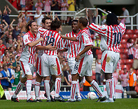 Photo. Glyn Thomas.Digitalsport<br /> Stoke City v Wolverhampton Wanderers. <br /> Coca Cola Championship. 08/08/2004.<br /> Stoke's Clive Clarke (second from L) celebrates with teammates after scoring from the penalty spot to put his side two goals in front.