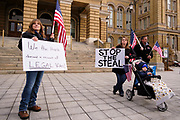 "21 NOVEMBER 2020 - DES MOINES, IOWA: Supporters of Donald Trump on the steps of the Iowa State Capitol during a ""Stop the Steal"" rally. About 100 supporters of US President Donald Trump gathered at the Iowa State Capitol to rally in support of the President and in opposition to the outcome of the US election. They are a part of the ""Stop the Steal"" movement which has spread across the US. This is the third week that there have been ""Stop the Steal"" rallies across the US. Most independent observers and election officials, both Republican and Democratic, have said the election was free and fair and that there was no election fraud.    PHOTO BY JACK KURTZ"