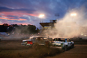 Racers collide during a heat race Monday as the demolition derby kicked off the 2011 Benton Franklin Fair & Rodeo in Kennewick.