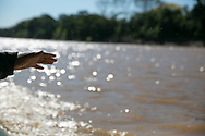 Jalen Pettus, 15, enjoys his first boat ride on the Madre De Dios River in the Amazon jungle.