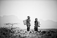 Women walking with water, Korr Village. Gurati Dere, MR#107. Lagoya Othola, MR #108.