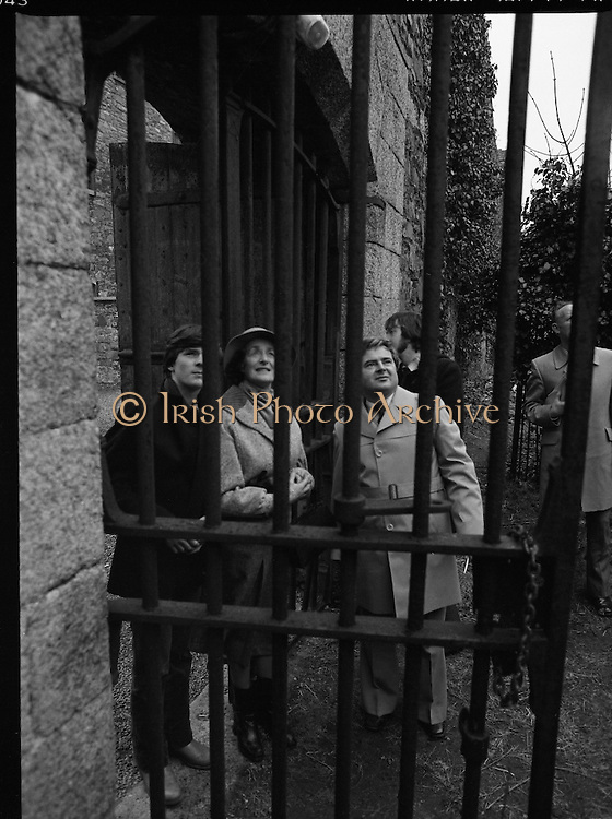 """The """"Asgard """" at Kilmainham Jail..1979..01.04.1979..04.01.1979..1st April 1979..The historic yacht """"Asgard"""" owned by Erskine Childers was brought to Kilmainham Jail,Dublin. The vessel had to be hoisted ,by crane,over the outer wall of the jail. It was placed as part of a future exhibition to be set up by The National Museum..Mrs Erskine Childers is pictured as she watches the yacht being hoisted into the air."""