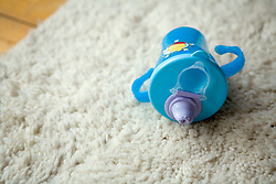Baby's cup on the floor,