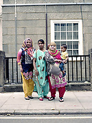 Three Bangladeshi women in traditional sarees with young boy during the Somers Town Festival on 09th July 2016 in London, United Kingdom. Somers Town, a district in north west London, is a large housing estate nestled between Euston, St Pancras and Kings Cross Library. Predominantly filled with social housing for the past 200 years, much of the area's housing was built in the twentieth century by the local authority.