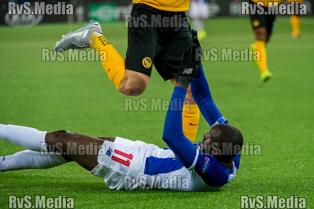 BERN, SWITZERLAND - NOVEMBER 28: #11 Moussa Marega of FC Porto clashes with #5 Cedric Zesiger of BSC Young Boys during the UEFA Europa League group G match between BSC Young Boys and FC Porto at Stade de Suisse, Wankdorf on November 28, 2019 in Bern, Switzerland. (Photo by Robert Hradil/RvS.Media)