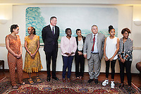 ROME, ITALY - 21 JULY 2014: Mayor of New York Bill De Blasio and Cécile Kyenge (center), former Italian Integration Minister and currently a member of the European parliament, are here for a photo spray with their respective families, at an exclusive social club in Rome, Italy, on July 21st 2014.<br /> <br /> New York City Mayor Bill de Blasio arrived in Italy with his family Sunday morning for an 8-day summer vacation that includes meetings with government officials and sightseeing in his ancestral homeland.