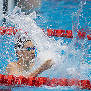 TOKYO, JAPAN - JULY 30:    Shun Wang of China celebrates winning the gold medal in the 200m individual medley for men during the Swimming Finals at the Tokyo Aquatic Centre at the Tokyo 2020 Summer Olympic Games on July 30, 2021 in Tokyo, Japan. (Photo by Tim Clayton/Corbis via Getty Images)