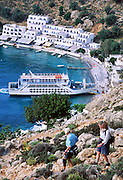 Loutro harbor, Crete, Greece: The only access to Loutro is by foot, ferry, or private boat on the Mediterranean Sea. Hikers exploring the rugged coast smell a rich fragrance of wild herbs.