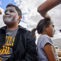 Armando Esparza, left, and Shelby Lee get their makeup done for the 2nd annual Tsehootsooi Medical Center Zombie Run in Window Rock Saturday