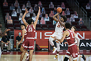 Southern California Trojans guard Ethan Anderson (20) shoots over Stanford Cardinal froward Brandon Angel (23) during an NCAA men's basketball game, Wednesday, March 3, 2021, in Los Angeles. USC defeated Stanford 79-42. (Jon Endow/Image of Sport)