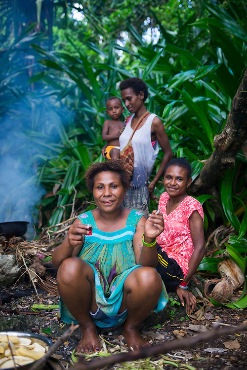 On Pig Island, located off the town of Madang in Papua New Guinea, locals enjoy a day-long outing to the small, uninhabited island, cooking out and enjoying some cigarettes and alcohol as well.