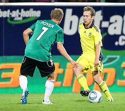 28.07.2011, Keine Sorgen Arena, Ried im Innkreis, AUT, UEFA EL Qualifikation, SV Josko Ried vs Brondby IF, im Bild Daniel Royer, (SV Josko Ried, #7) und Anders Randrup, (Brøndby IF, Defense, #2) // during football match between SV Josko Ried (AUT) and Brondby IF (DEN) 1st Leg of Europa League third Qualifying Round, on July 28, 2011 at Keine Sorgen Arena Ried im Innkreis, Austria. EXPA Pictures © 2011, PhotoCredit: EXPA/ R. Hackl
