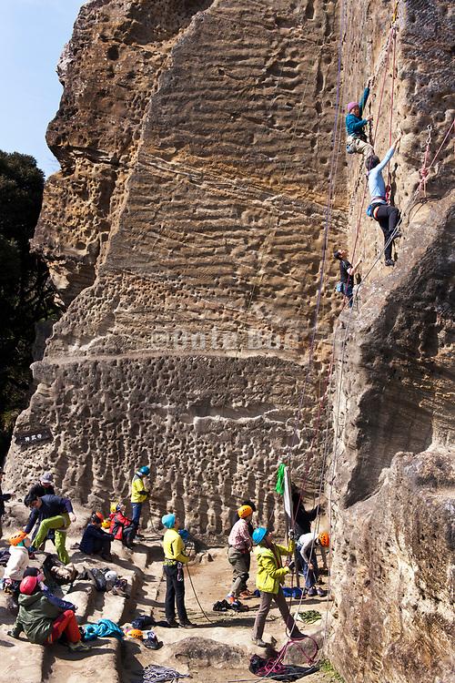 climbing of a vertical rock mountain wall Japan