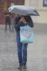 © Licensed to London News Pictures. 28/07/2021. Sheffield, UK. A woman braves the rain in Sheffield as parts of Yorkshire are hit by heavy rain and thunderstorms. Photo credit: Ioannis Alexopoulos/LNP