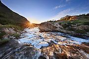 Sunrise over Swiftcurrent Falls, Glacier National Park.