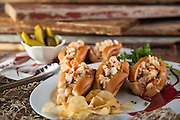Nothing says fresh Maine lobster like a decadent lobster roll. This image was photographed for a lobster company in Stonington, Maine. Some of the best lobsters come from this area.