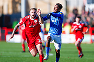 Accrington Stanley defender Nick Anderton (24) on loan from Blackpool, challenges Portsmouth forward Jamal Lowe (10)  during the EFL Sky Bet League 1 match between Accrington Stanley and Portsmouth at the Fraser Eagle Stadium, Accrington, England on 27 October 2018.