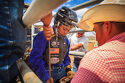 14 JULY 2012 - OAK SPRINGS, AZ: A boy gets set to ride a steer during a bull riding class at the Aspen Canyon Rodeo Club in Oak Springs, AZ, Saturday. The bull riding class was offered by the Crooked Horn Cattle Co. in the community of Oak Springs on the Navajo Nation, about 15 miles south of Window Rock, AZ. Eleven cowboys signed up for bull riding classes and one signed up for bull fighting classes. The bull riding class started with lessons on a mechanical bucking machine before the cowboys rode bulls.    PHOTO BY JACK KURTZ