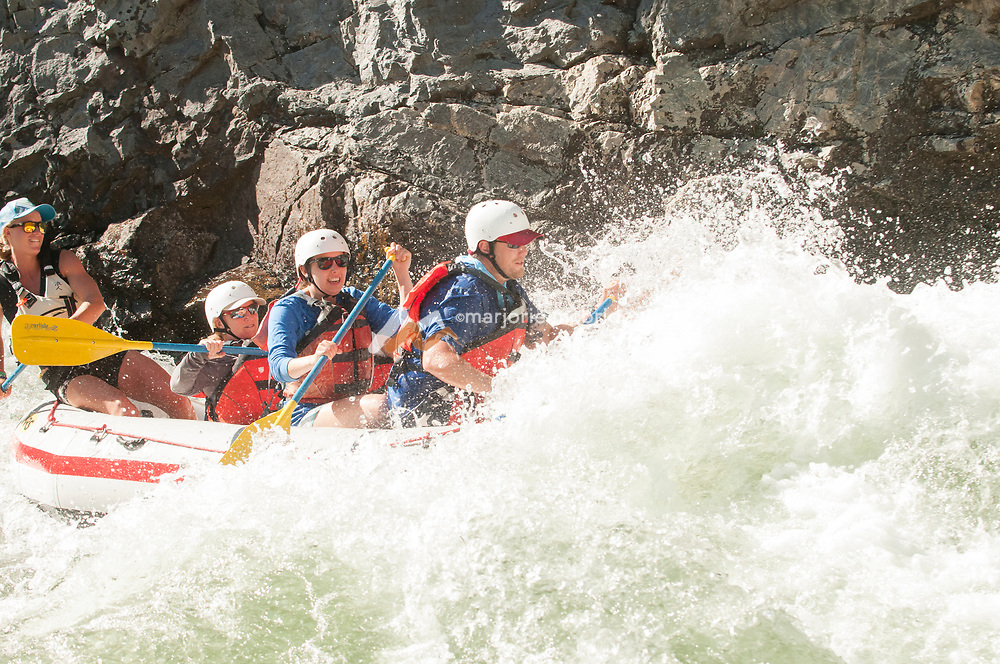 Enjoying whitewater at Cliff side rapid in the Impassible Canyon on the Middle Fork of the Salmon River during six day rafting vacation, Idaho.