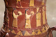 Close up of the Inandik Hittite relief decorated cult libation vase decorated with women relief figures coloured in cream, red and black playing instruments, mid to late 16th century BC - İnandıktepe, Turkey. Against a warm art background