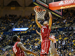 Jan 6, 2018; Morgantown, WV, USA; Oklahoma Sooners center Jamuni McNeace (4) dunks the ball during the first half against the West Virginia Mountaineers at WVU Coliseum. Mandatory Credit: Ben Queen-USA TODAY Sports